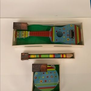New. Kids toy ukulele, recorder, tambourine.